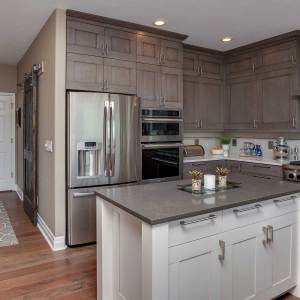 Transitional grey and white kitchen remodel in Highlands Ranch, CO near Denver, CO with island and glass backsplash.