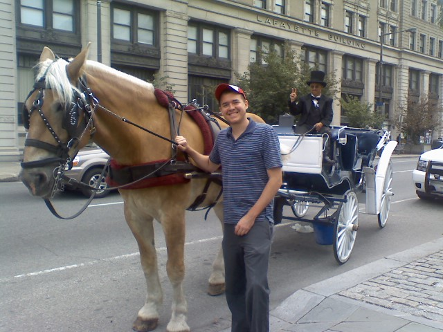 Chris Wink holding a horse by its bridal in Old City Philadelphia