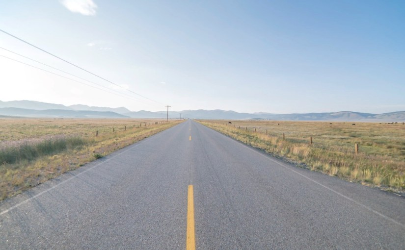 Photo of rural highway looking long and empty