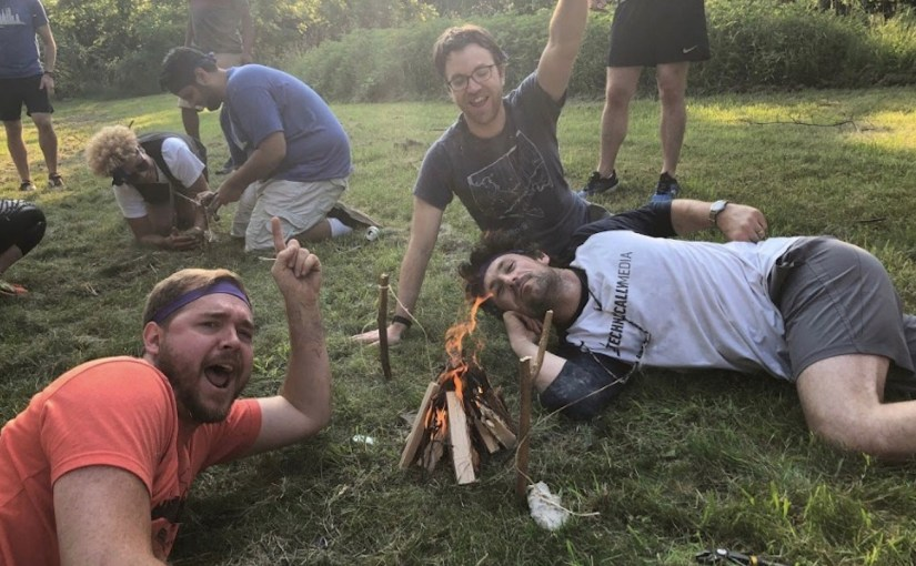 three of us cheering around a camp fire we made