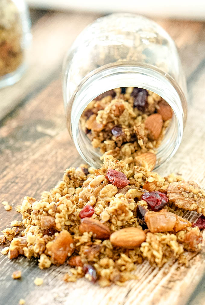 Pear and Cranberry Granola Spilling out of mason jar