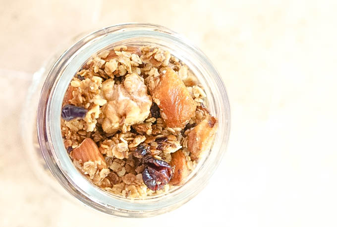 Overhead shot of mason jar with homemade pear and cranberry granola