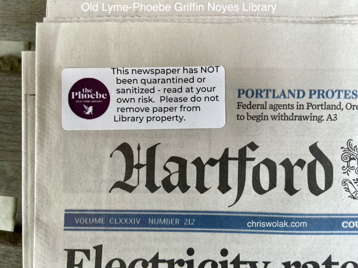 Close up of sticker stating the newspaper has not been quarantined or sanitized Hartford Currant at Old Lyme-Phoebe Griffin Noyes Library