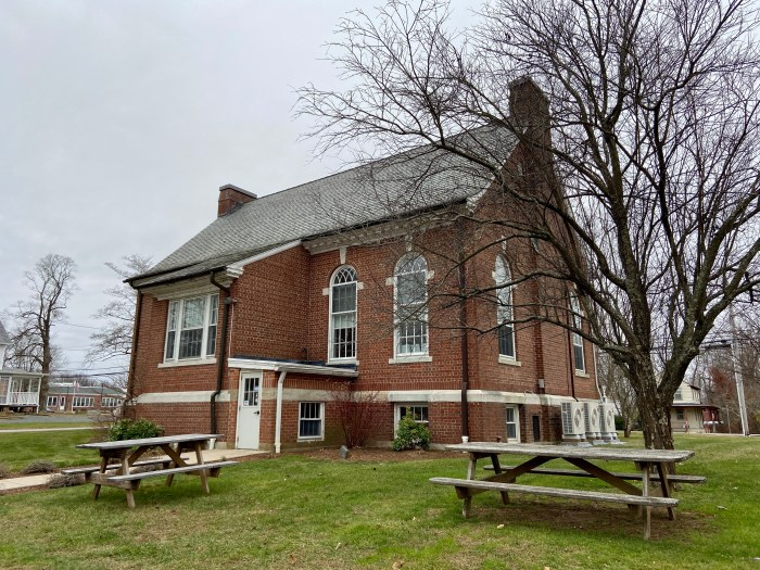 Rear facade with picnic tables - East Haddam Free Public Library