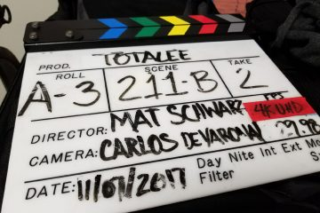 a film slate being used on a video shoot