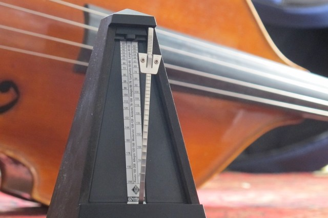 Classic style metronome and wood stringed bass