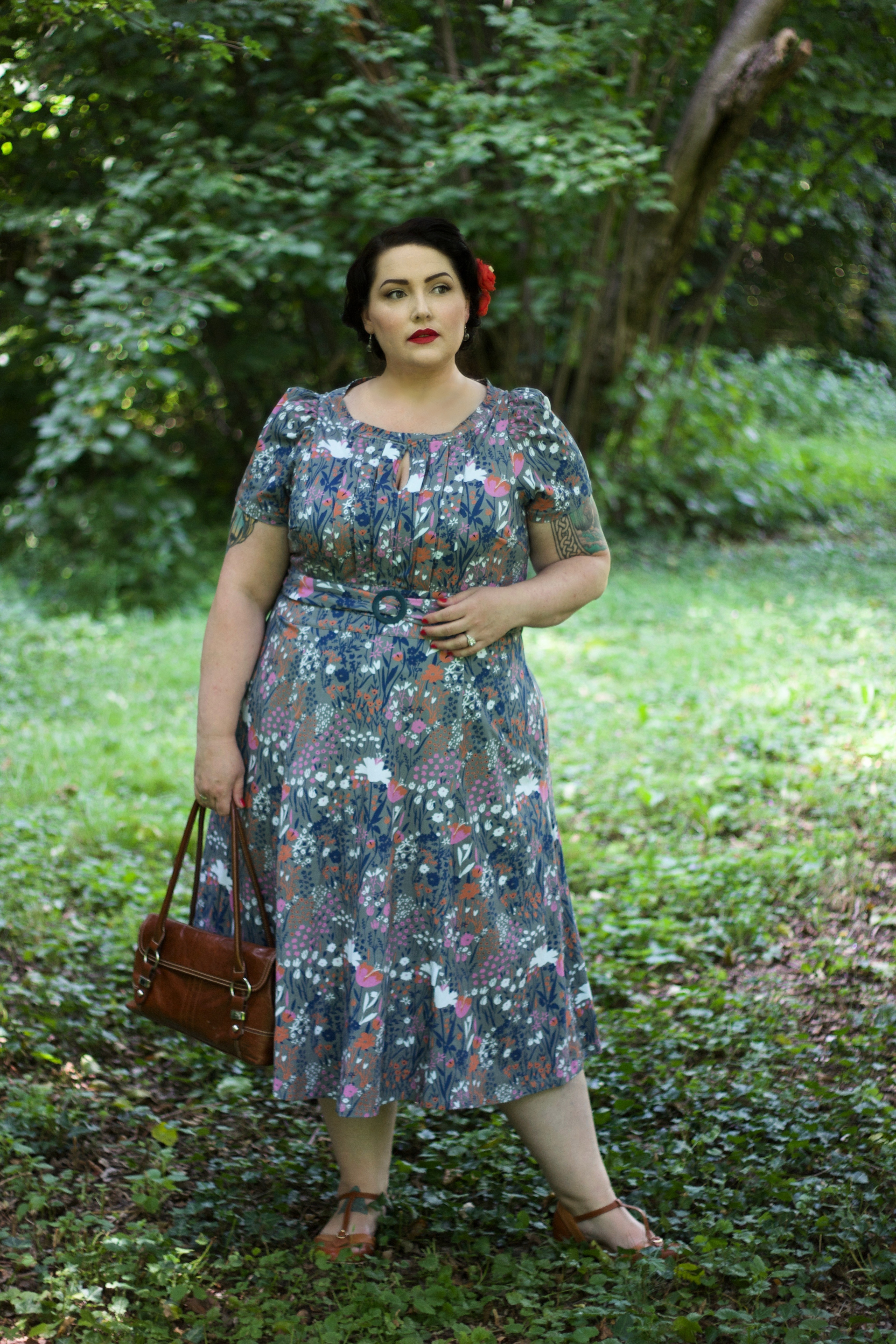 Vintage style woman in grey floral dress