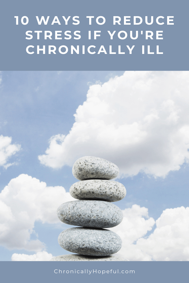 A stack of pebbles with clouds in the sky in teh background. Title reads: Ten ways to reduce stress if you're chronically ill.
