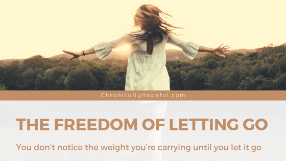 A woman dancing in a field at sunset. TItle reads: the freedom of letting go. You don't notice the weight you're carrying until you let it go.