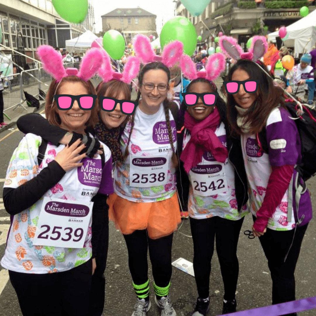 The 5 Bouncing Pink Bunnies, wearing their Marsden March shirts, black leggings and pink bunny ears at the starting line of Marsden March, Chronically Hopeful