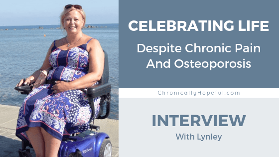 Title reads, Celebrating Life despite chronic pain and Osteoporosis, Interview with Lynley. Below is a photo of a lady wearinga blu dress, sitting in a power chair at the beach with the sea in the background,pin by Chronically Hopeful