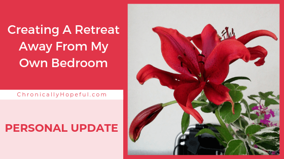 A beautiful red Lily. Title reads: Creating a retreat away from my own bedroom, personal update.