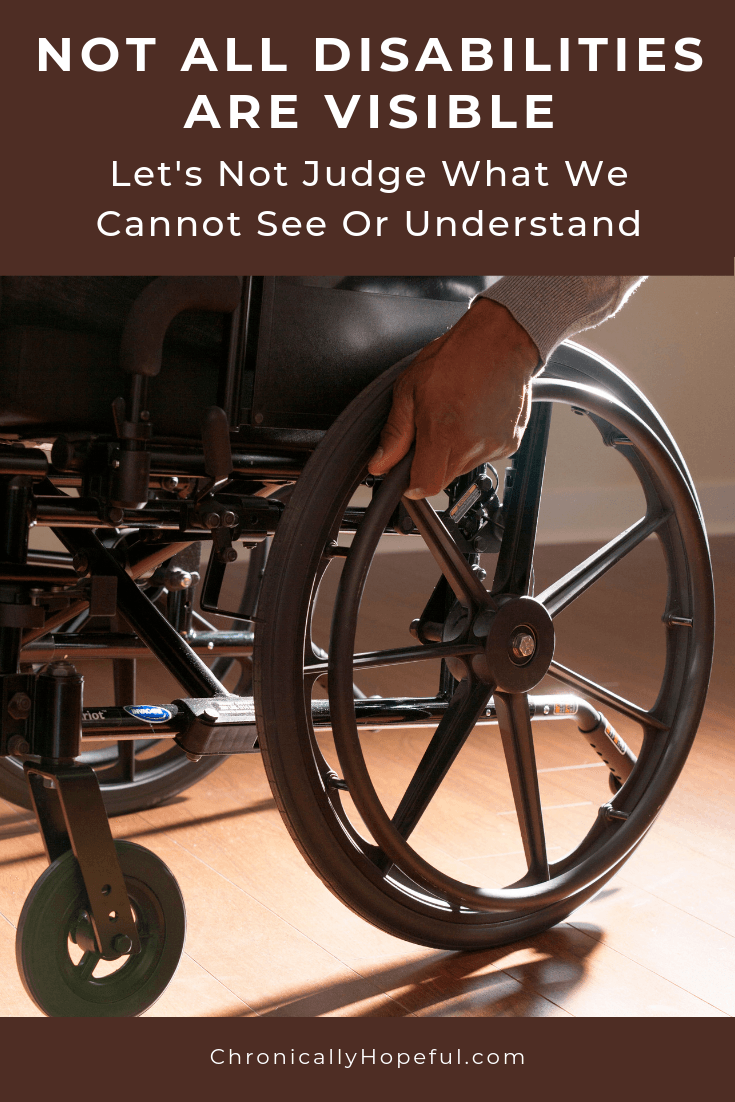Man in a wheelchair with his hand on the wheel. Title reads: Not all disabilities are visible. Let's not judge what we cannot see or understand.