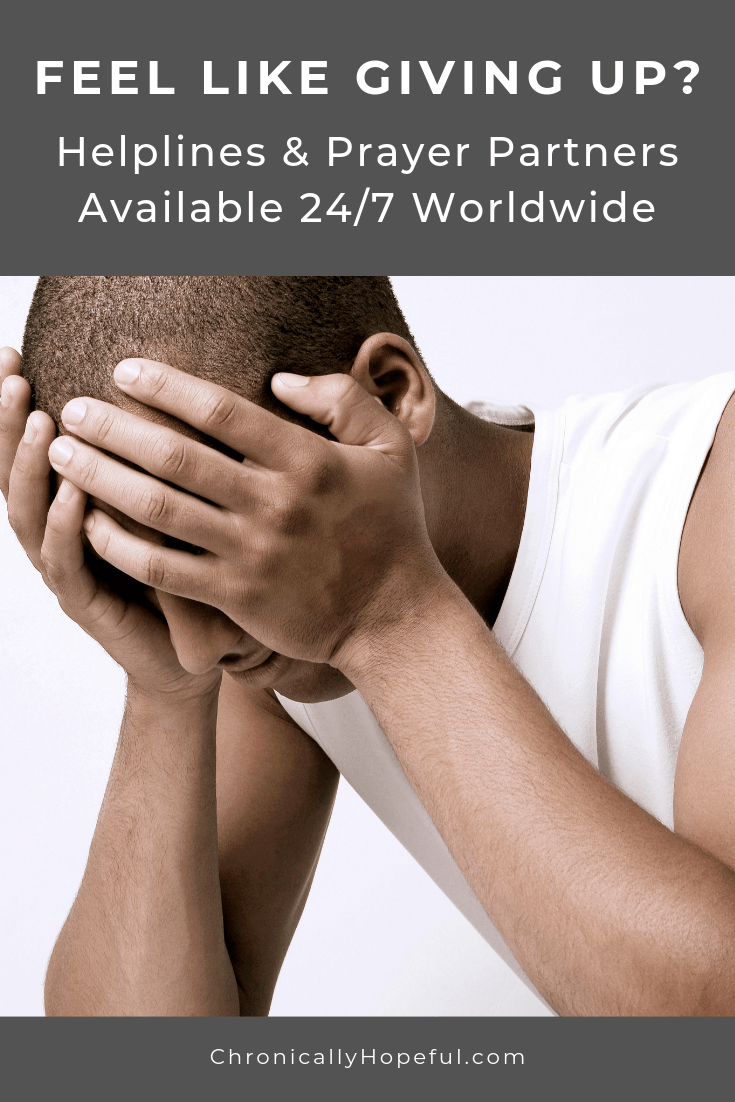 Man holding his head in his hands. Title Reads, Feel like giving up? Helplines & Prayer Partners available 24/7.