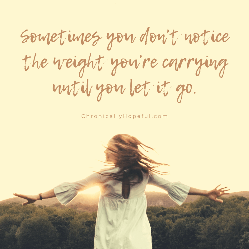 A woman dancing in a field at sunset.  Quote reads: Sometimes you don't notice the weight you're carrying until you let it go.