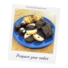 A blue plate with cookies and brownies