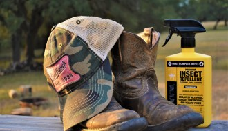 Outdoor gear sitting next to permethrin spray bottle