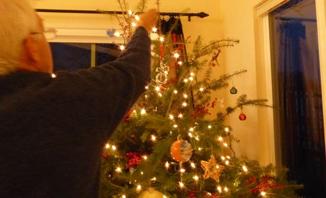 Decorating our tree on the Solstice this year