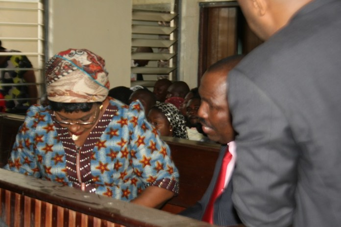 Dr. Angela Uwakwem (L) and Emmanuel Ajayi (M) during court proceedings