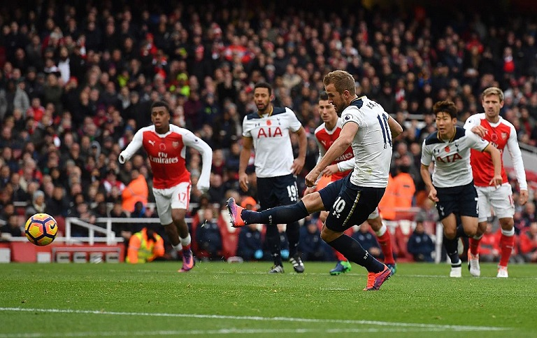 Harry Kane scored from the spot to hand Tottenham a draw against Arsenal at the Emirates Stadium Photo: Tottenham/Twitter