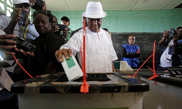 Joseph Boakai casts his vote in the first round of Liberia's presidential election.