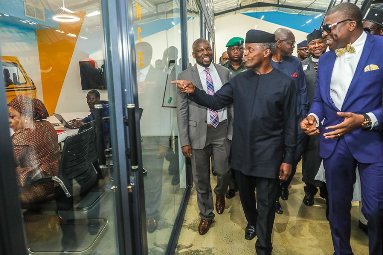 Vice President Yemi Osinbajo takes a tour around Vibranium Technology Park, led by Executive Director Venture Garden Group, Kunmi Demuren; CEO Venture Garden Group, Bunmi Akinyemiju and other tech innovators
