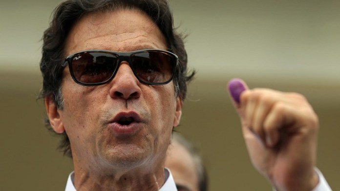 Ex-cricketer Imran Khan in early lead in Pakistan election