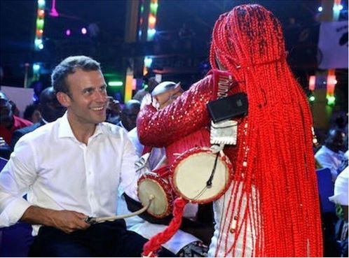 French President Emmanuel Macron drumming at the Afrika Shrine in Ikeja, Nigeria