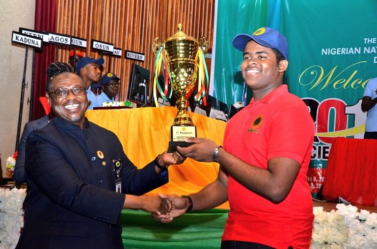 NNPC GMD Maikanti Baru presenting winner Okeke Tony Kabilan with his prize