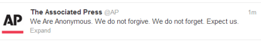 An enraged employee of the Associated Press tweeted support for Anonymous.