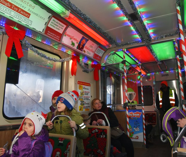 From Left Xia Roberts  Of Evanston And Liam Lockwood Also Of Evanston Ride The Cta Holiday Train With Family On The Dec   Purple Line