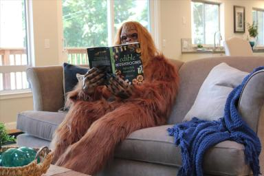 Daniel Oster as Bigfoot Reading in the Living Room