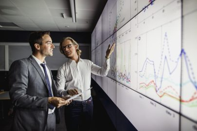 Two business professionals analysing data