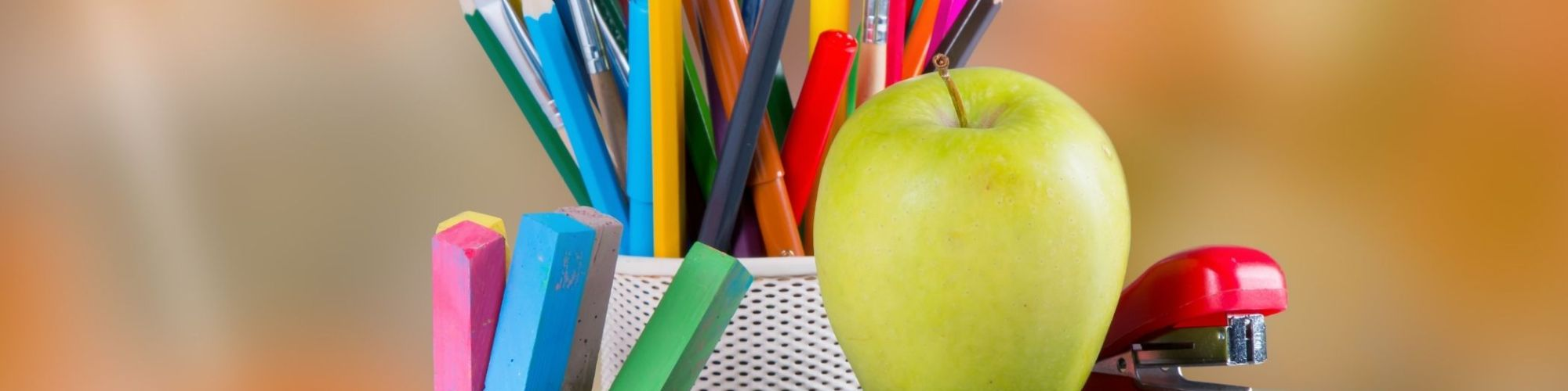Picture of School Supplies and Apple