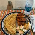 Tomato, Spinach, Bacon, and Feta cheese omelette (well done like we Nigerians like it) with fried plantains, sliced oranges, and a guava disc. Getting the hang of this cooking thing. #ChubanatorCookingSkills.