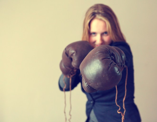 Young girl  with boxing glove