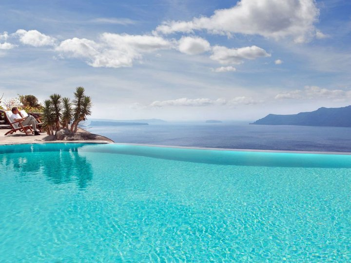 the-perivolas-hotel-in-greece-has-the-ultimate-infinity-pool-with-blue-water-that-seems-to-spill-out-right-into-the-mediterranean