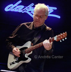 Bill Frisell holding guitar