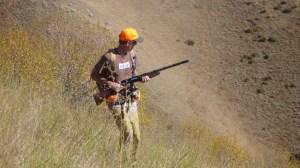 man holding shotgun in ready position