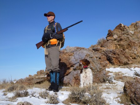 Man and dog looking for chukar