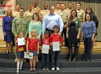 Student Essay winners proudly stand with Veterans.