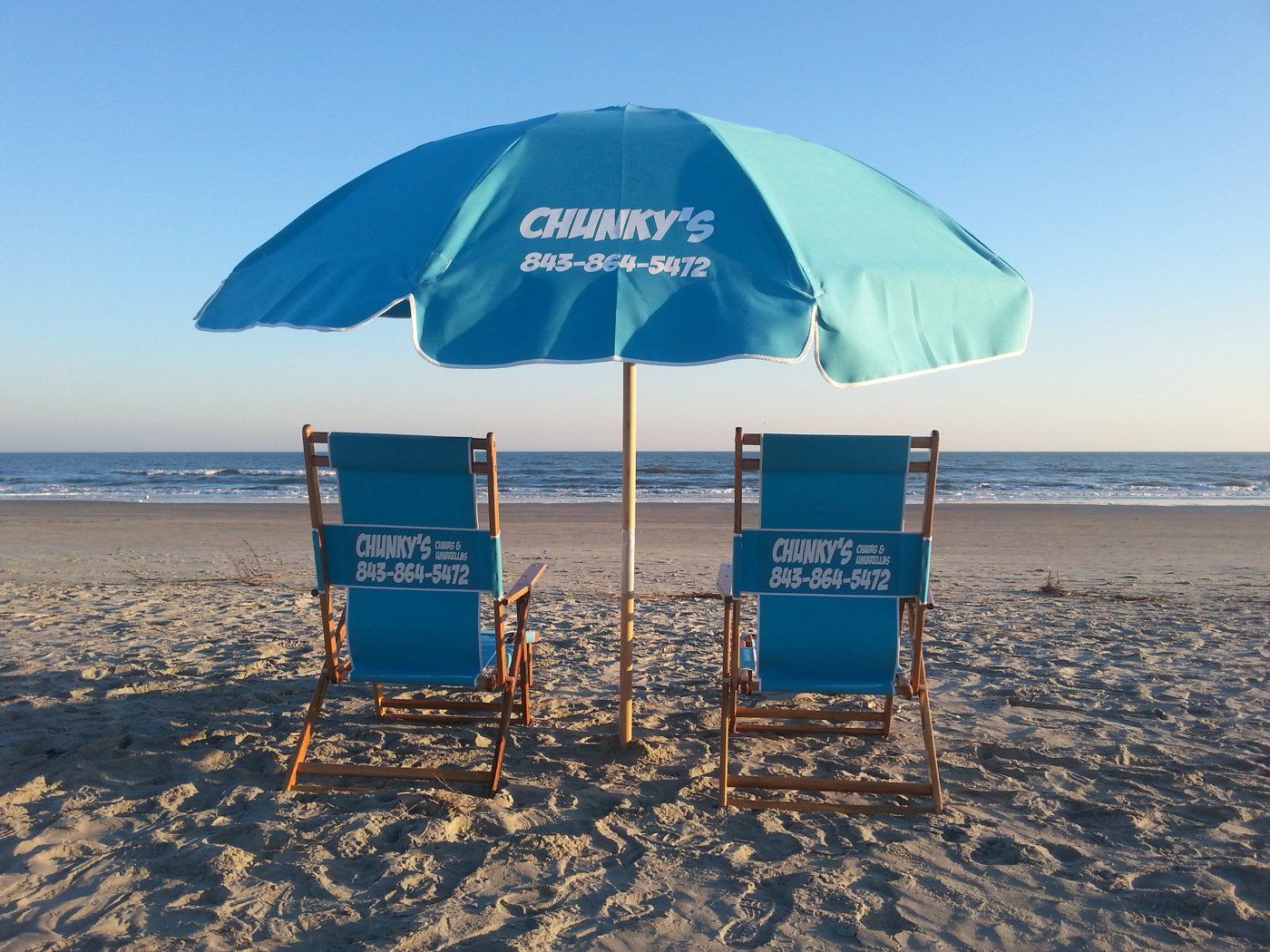 beach chair rental isle of palms shower with back and armrests chunky s chairs umbrellas umbrella rentals adult