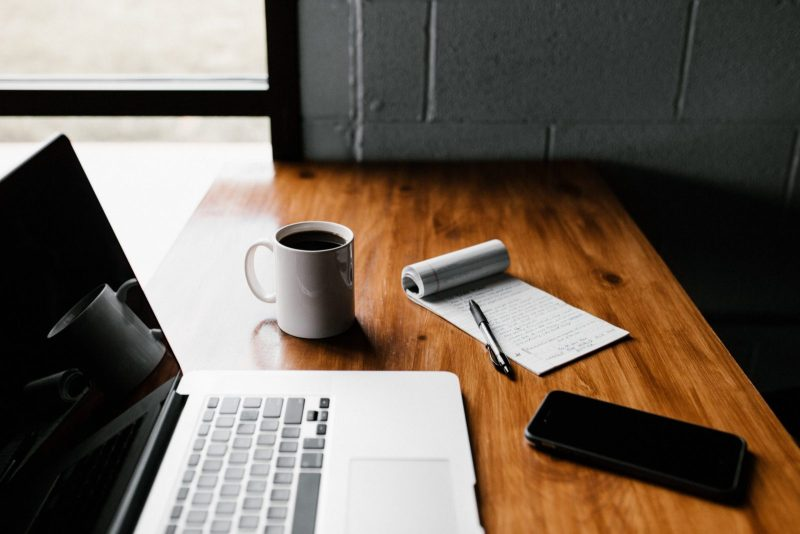 Article featured image of computer on a desk with a cup of coffee and notepad