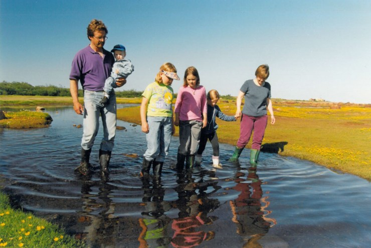 Mike and Jeanne Reimer and family out for a stroll through one of the many creeks along the Hudson Bay coast.
