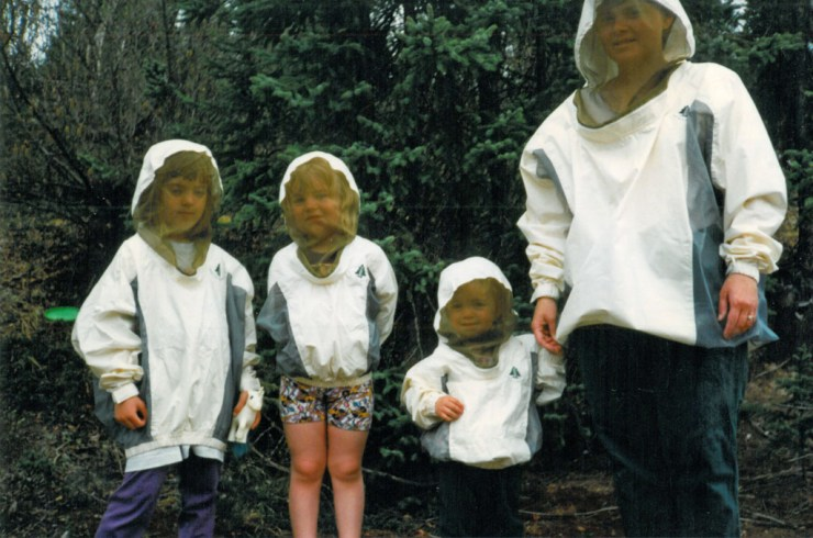 (L-to-R) Rebecca, Karli and Allison Reimer with Mom Jeanne. Bug suits on! Well, sort of.