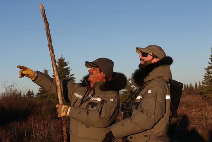 Polar bear guides Albert Saunders and Steve Schellenberg see something they like! Egle Hansen photo.