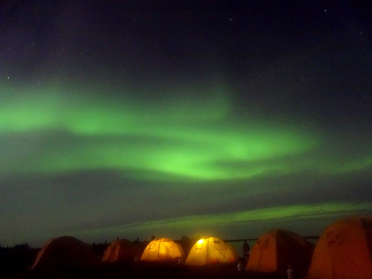 Tundra camp under the northern lights at Schmok Lake. Click image for story.