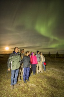 Guests and northern lights at Nanuk Polar Bear Lodge.
