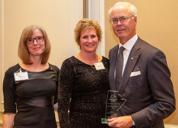 Hartley T. Richardson receives Ducks Unlimited Canada 2019 Conservation Education Award. L to R: Nathalie Bays, Manager of Interpretive Centre Operations; Dr. Karla Guyn, CEO Ducks Unlimited Canada; Hartley T. Richardson, CEO James Richardson & Sons Limited.