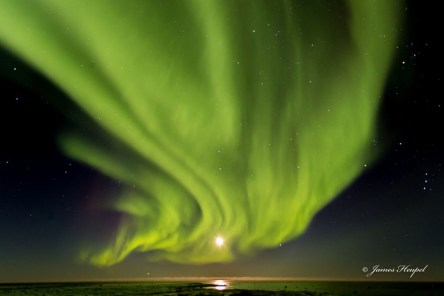 Curtain of northern lights over full moon. Seal River Heritage Lodge. James Heupel photo.